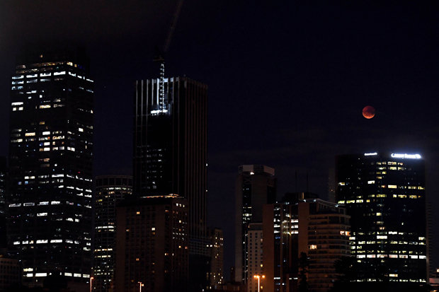A perfectly round red moon can be seen above Sydney, Australia